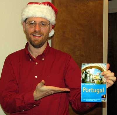 Barry in his Christmas hat with our Rough Guide to Portugal