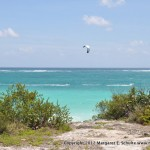 View of the Caribbean and kite surfer at Tulum ruins.