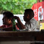 Locals enjoy a beer at the bar.