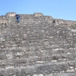 Philip climbs the structure at Chacchoben, with special permission.