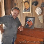 Master Carver Alfredo Gonzales, with his autographed photo of John Glenn. Gonzales' reproductions of ancient carvings are found in collections around the world.