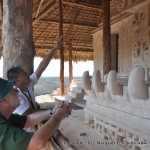 Our guide points out details of the tomb carvings at Ek'Balam to Philip.