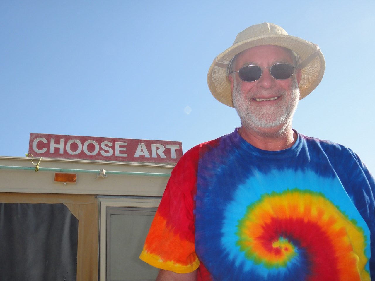Burning Man 2013. He loved the Choose Art sign that Barry and I made and used it to decorate his home.