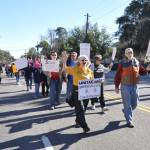 Unitarian Universalists of Coastal Georgia, led by Rev Jane Page, march past their church