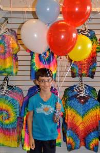 Little boy with balloons inside the store