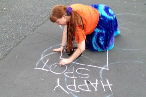 Drawing a happy spot in chalk