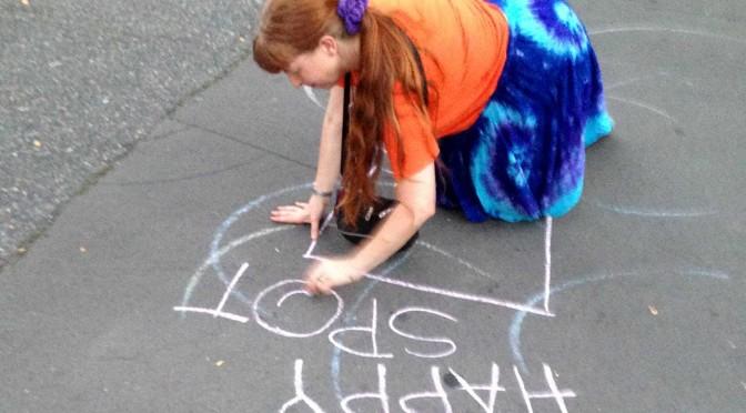 Drawing a happy spot in chalk