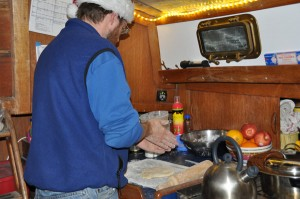 Barry rolling out the noodles. This shows just how tiny our galley is -- Barry's working on top of the icebox, next to the stove.