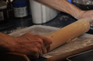 Barry's using our rolling pin on top of a silicone mat to roll the noodles.