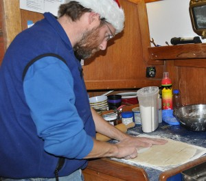 Barry uses a plastic knife to cut the dough into square noodles.