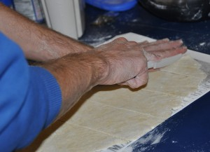 Barry cutting the noodles on the silicone mat.