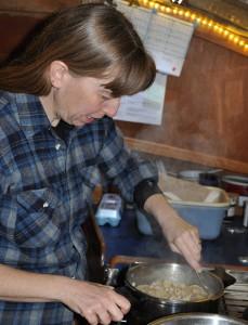 Margaret stirs in leftover turkey from Christmas dinner.