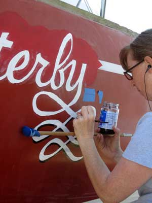 Meps paints the name on Flutterby