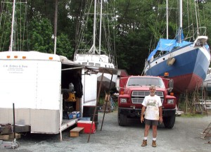 Charlie, with his trailer, truck, and boat