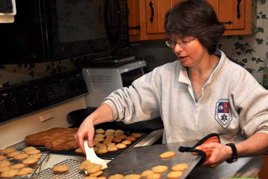 Sandy bakes a test batch of cookies
