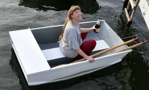 Margaret Meps Schulte christens her Tortoise dinghy