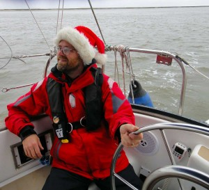Barry wearing a Santa Claus hat and steering Flutterby