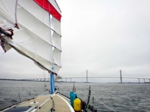 Flutterby's mainsail and the Sidney Lanier bridge in the distance
