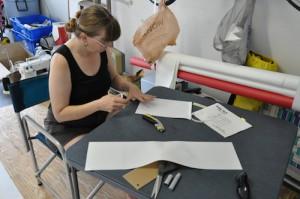 Margaret attaching tape to batten pockets