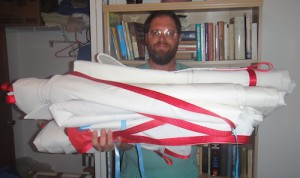 Barry holding a stack of folded sails