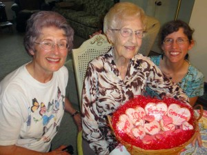Sharon, Loraine, and Julie with 100th birthday cookies