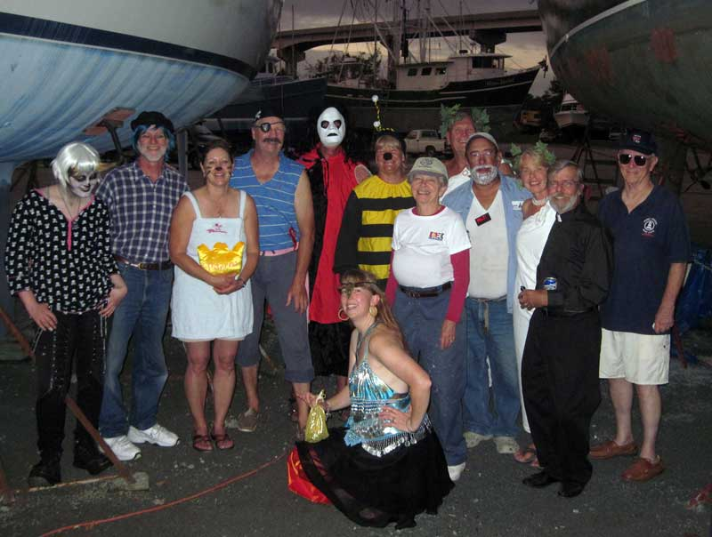 The whole dressed-up gang, complete with jackstands and boats on either side of us. Scary!