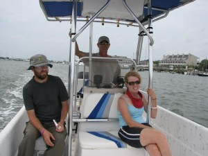 Barry, Kenny, and Nancy on the boat with Beaufort in the background