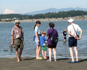 Barry, Julie, Gabriel, Sharon, Emanuel, and Dave wading at Iverson Spit with Mount Baker in the background