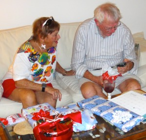 Joy and Dad opening Christmas presents, 2012