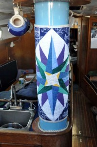 Mast inside the boat with quilt on it