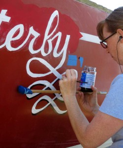 Painting Flutterby's name with a marl-stick