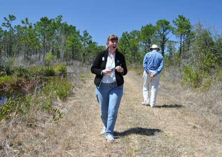 Margaret and her Dad hiking in the wildlife refuge