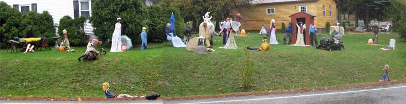 I had to stitch two photos to get 25 of the scarecrows and effigies -- and there were three more on the left!